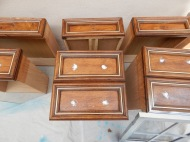 Drawer pulls removed and holes filled with wood filler