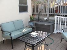 Before the deck was replaced - note the neighbor's AC unit and crumbling wall.